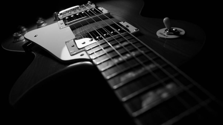 Guitars-Wallpaper-1920x1080-Guitars.jpg